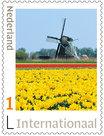 Postzegels voor Postcrossing - molen met tulpen