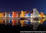 ansichtkaart Reitdiep haven in Groningen bij avond